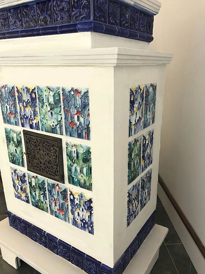 Two small whitewashed stoves, made in the style of antique European stoves with handmade tiles.