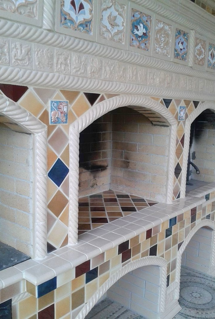 A outdoor kitchen tiled oven in Neo-Russian-style with large rump relief tiles and multi-colored majolica.