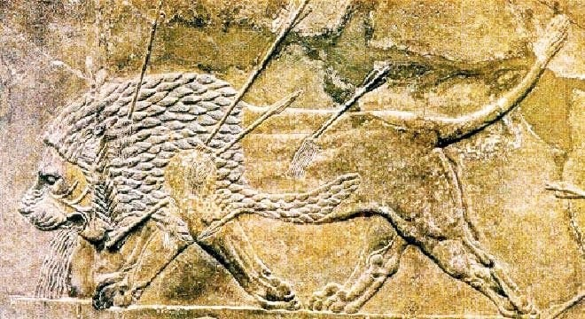 Royal hunt, a relief in Ashurbanipal's Palace. Ceramics of Babylon