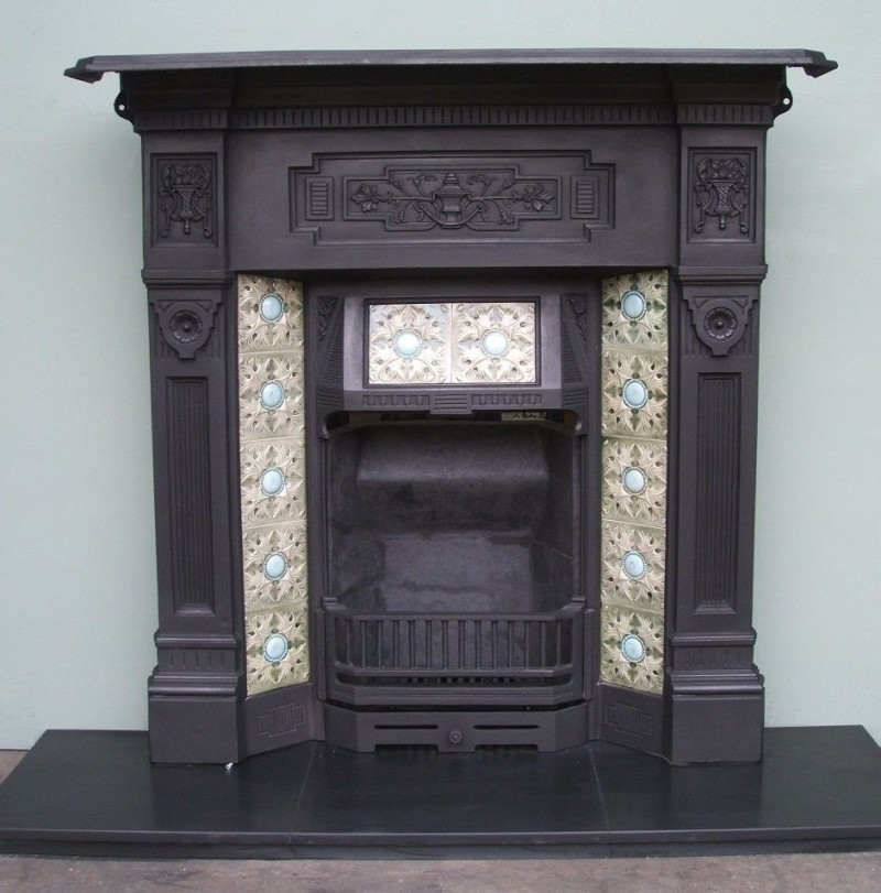 Victorian english fireplace with relief tiles