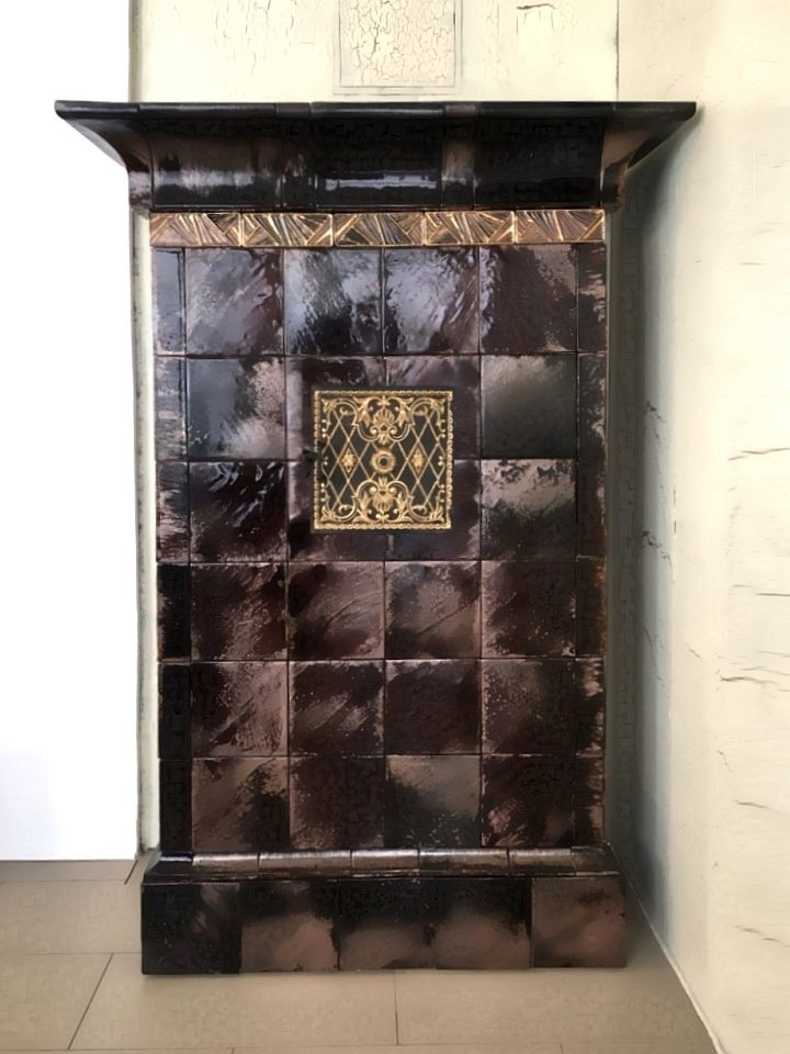 A small vintage tiled stove, made in the style of northern antique stoves