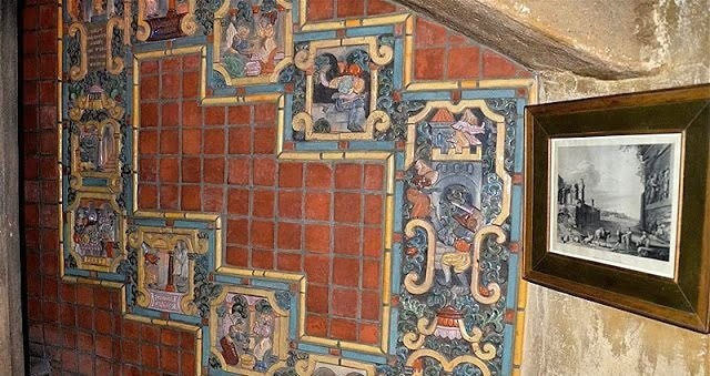 A wall in Mercer museum clad with Moravian Pottery tiles