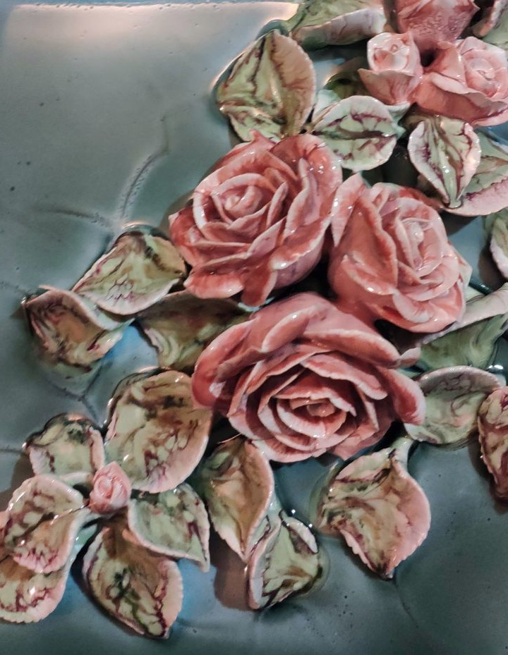 Handmade ceramic floral decor for fireplace with many rose
