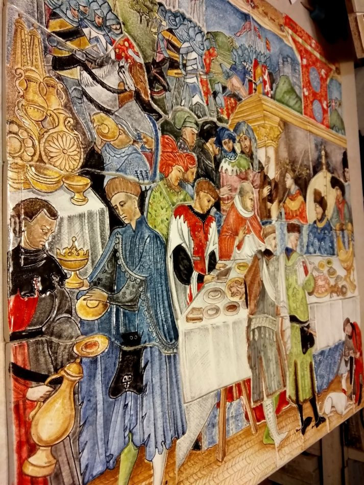 Book Of Hours ceramic mural on wall