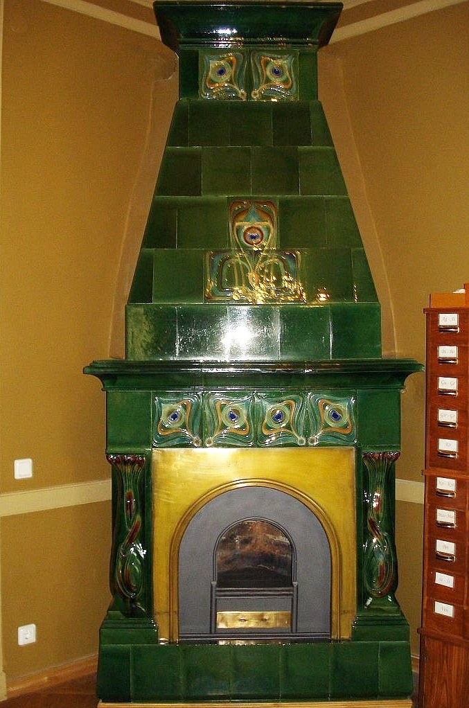 Art Nouveau green antique ceramic stove in the bedroom