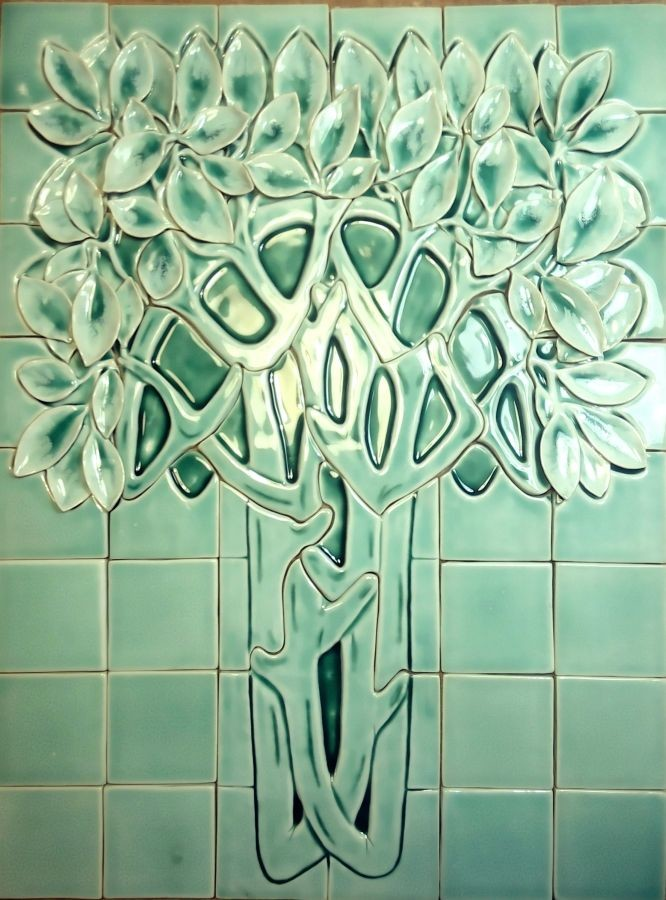 Frosty tree relief ceramic mural for stove