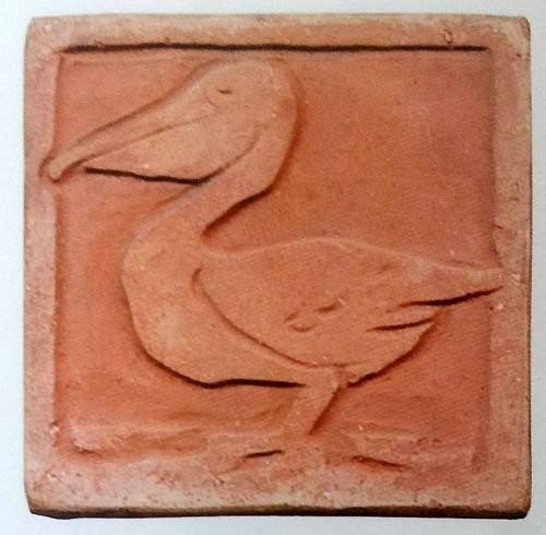 A terracotta floor tile by Grueby Pottery