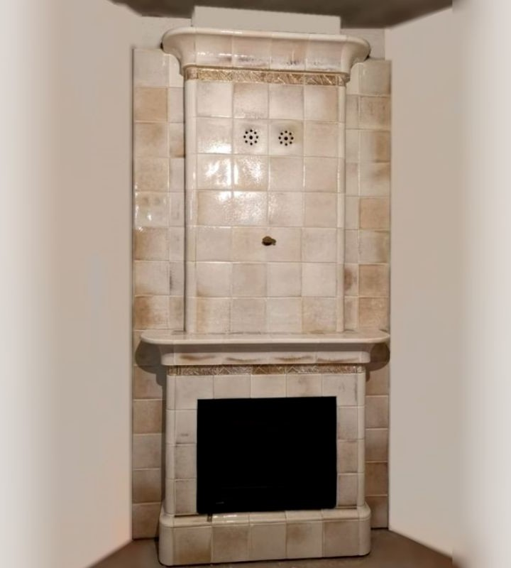 An elegant tiled fireplace Art Deco in complex glaze with pearl effect and crystals