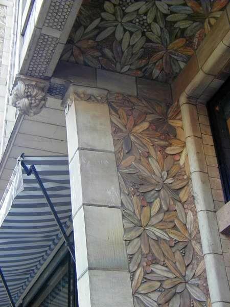 Alexandre Bigot's ceramic decor on the windows of Perret's house on Benjamin Franklin Avenue